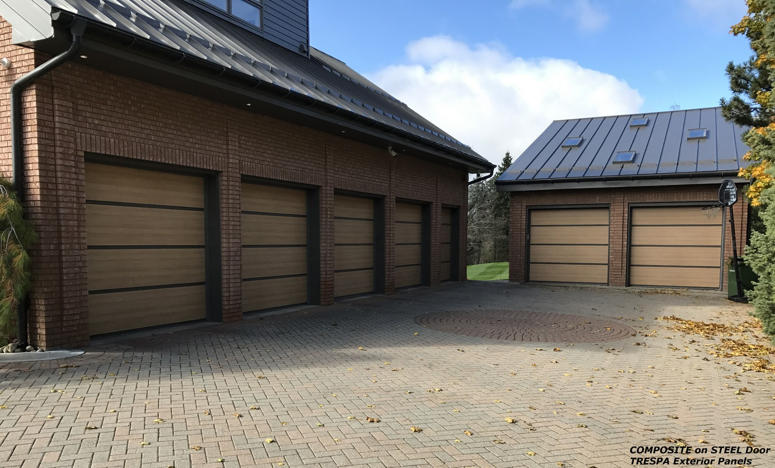 Composite on steel garage doors facade door systems for Composite wood garage doors