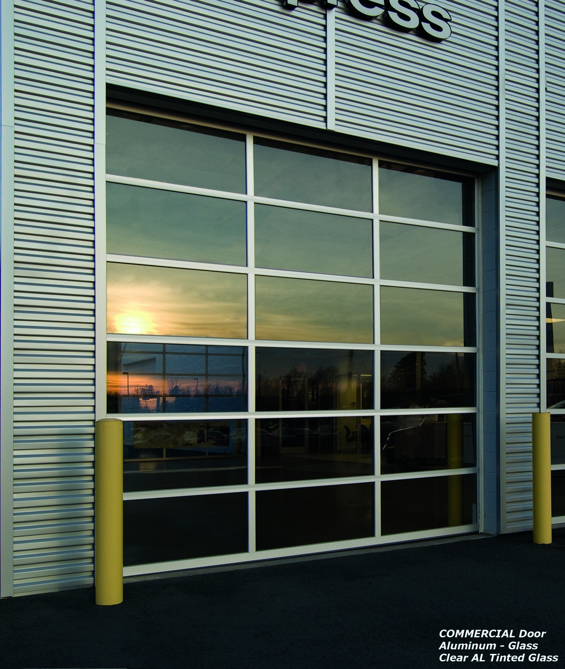 Commercial sectional garage doors facade door systems for Commercial entry doors